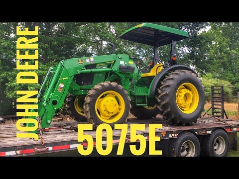 Unloading the John Deere 5075e and showing off the new loader - YouTube