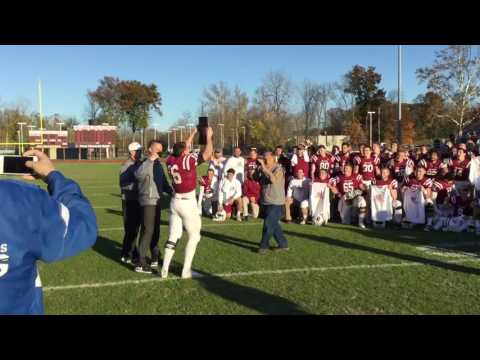 Football Team Accepts HCAC Trophy