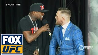Download Floyd Mayweather fires back at Conor McGregor 'The fans can't fight for you' | TOR | UFC ON FOX Mp3 and Videos