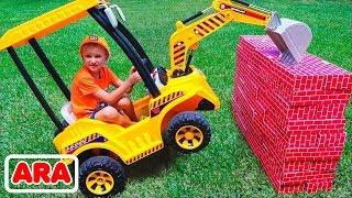 جرار يحطم الجدران وفلاد يركب على عجلة القوة لمساعدة الطفل