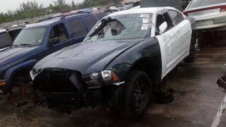 CHARGER COP CAR SHOT FULL OF BULLET HOLES & JUNKED