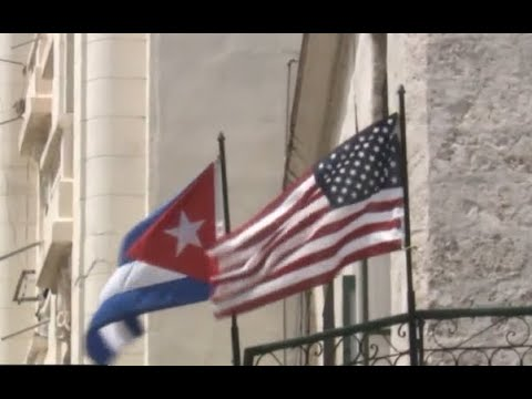 US urges no travel to Cuba, cuts embassy staff