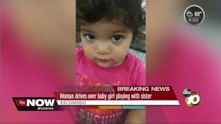 Woman drives over baby girl playing with sister