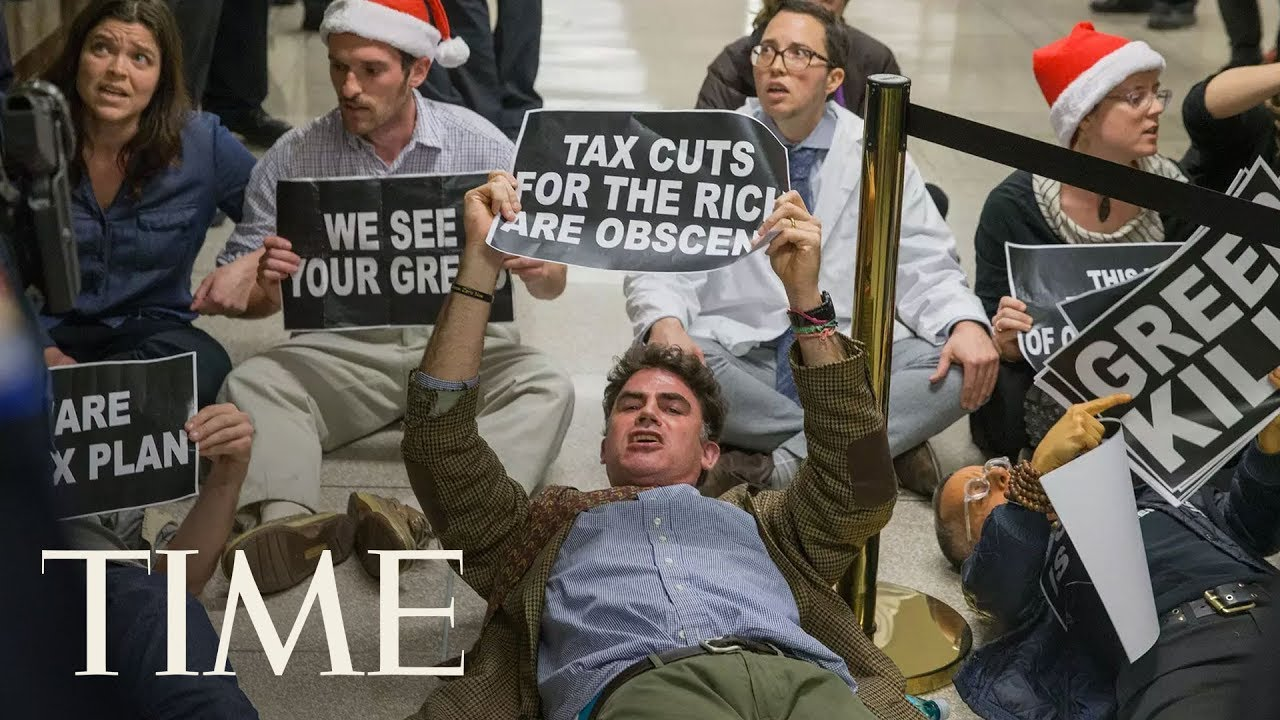 Protesters Dragged Out Of Senate Hearing: GOP Tax Bill Just Cleared Major Hurdle In Senate | TIME