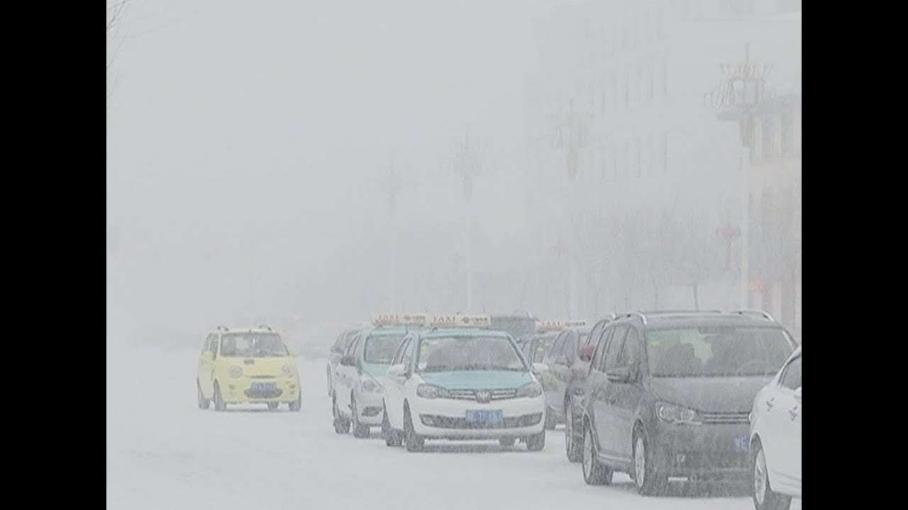 Cold Wave Brings Snow, Plunging Temperatures in North China City