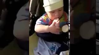 Funny kid eating ice cream with foot