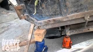 Overloaded ISUZU Elf Dumper truck Stuck and sink in the ditch