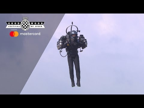 Incredible jet pack flies over Goodwood hill
