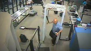 Video shows man storm TSA with machete