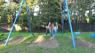 Doing Underdog with Girl on Swing