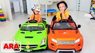 فلاد ونيكيتا يركضان على ألعاب سيارات العائلة الممتع