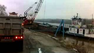 Coal being unloaded from a barge on Ohio river