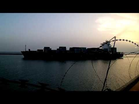 Lome Togo. Container vessel , go out from the port. / Контей