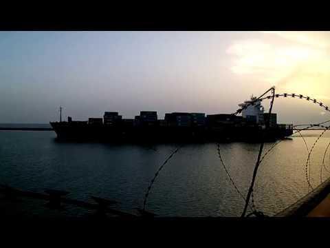 Lome Togo. Container vessel , go out from the port. / Контейнеровоз выходит из порта.