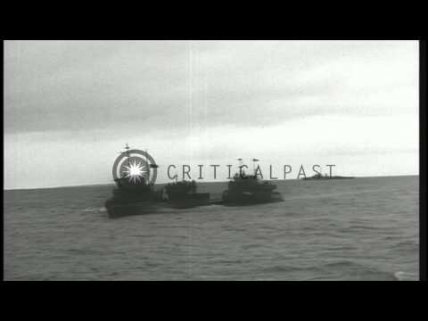 Flanked by US escorts, surrendered German submarine U-234 arrives at dock in Port...HD Stock Footage