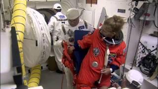 STS-135 Astronauts Strap Into Shuttle Atlantis