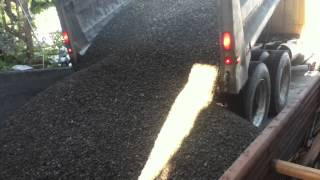 Dump Truck Dumps 10 Yards Of Gravel