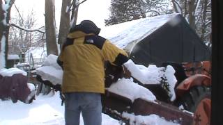 old kubota tractor moving snow