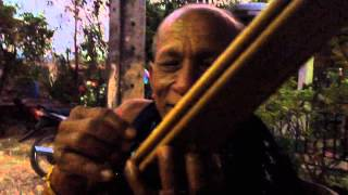 Khene player in Laos plays in different keys (lai)