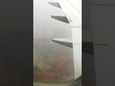 Oman air landing in Hyderabad, raining, time-lapse.