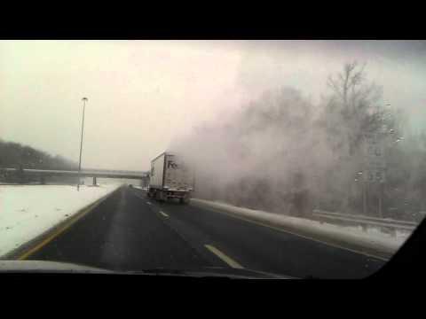 FedEx truck in snow.