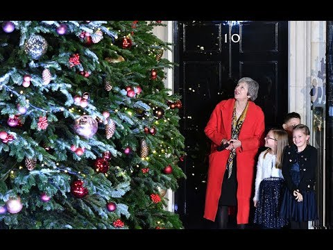 Theresa May switches on Downing Street Christmas lights