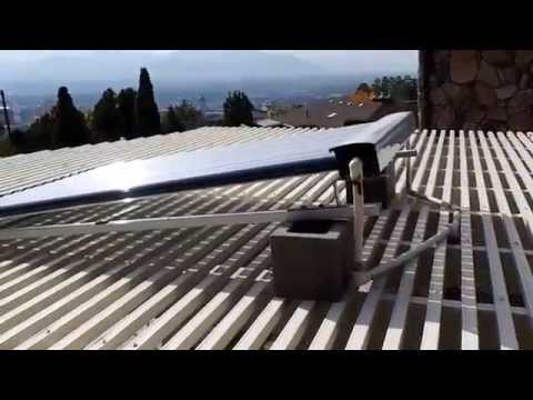 Solar heated hot tub using evacuated solar tubes
