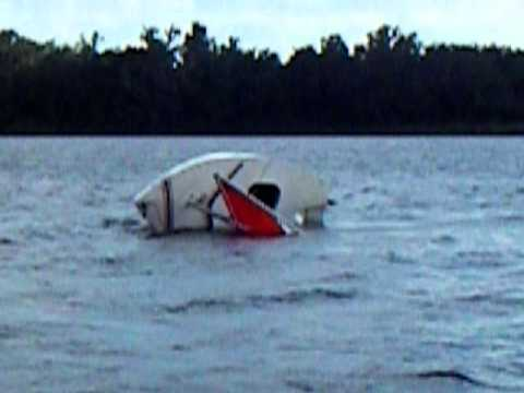 Demonstrating How To Right A Capsized Sunfish Sailboat