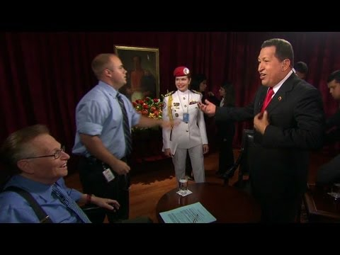 2009: Hugo Chavez sings with Larry King