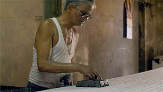 Block Printing - A traditional woodblock printing artist at work