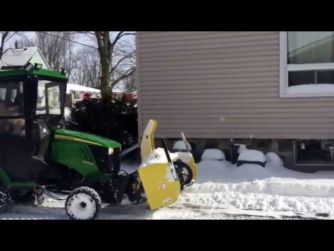 John Deere 1025R snow blowing The storm spent 13hrs Plowing and blowing  snow 28hr day, good night !