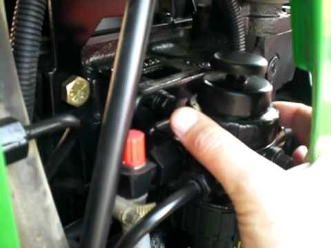 JD 5203 John Deere tractor fuel filter change - YouTube