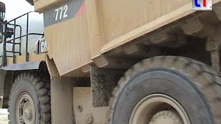 CATERPILLAR 772 Dump Truck in a Quarry / Steinbruch, Bavaria, 24.09.2009.
