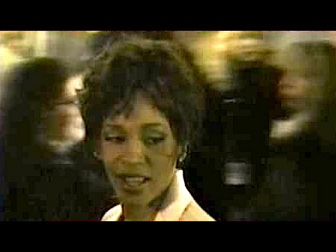 WHITNEY HOUSTON says hello while walking by outside concert