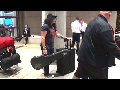 Guns N Roses Rocker Slash Makes His Way Through LAX