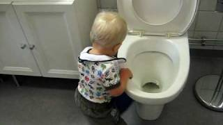 cute baby going crazy in the bathroom