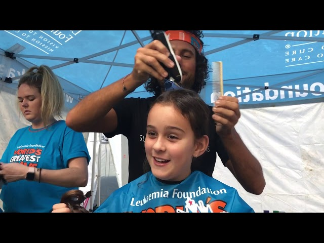 Paul cuts Katie's ponytails for World's Greatest Shave   Mar 2019