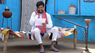 Happy Indian man received money and a letter of appreciation - financial concept. Rural home