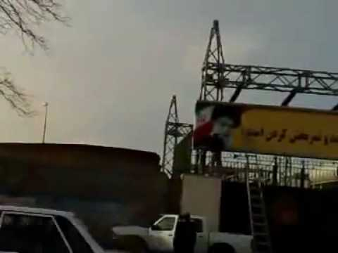 Regime is cleaning green paint of a banner with Khamenei - Iran Tehran 10 Feb 2010