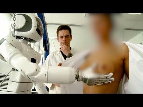 Робот исследует женскую грудь,  и определяет, настоящая ли она?