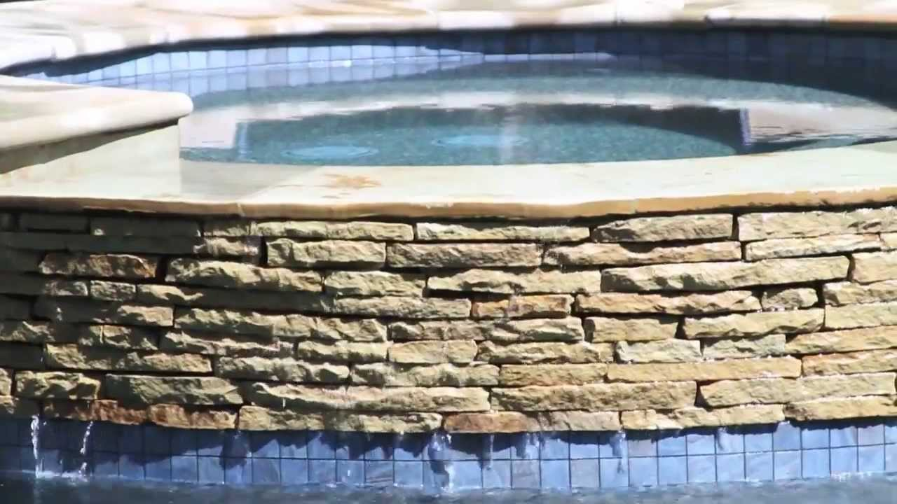 Stacked stone water feature - Charleston Pool Design With Stacked Stone Weeping Water Wall On Isle Of Palms