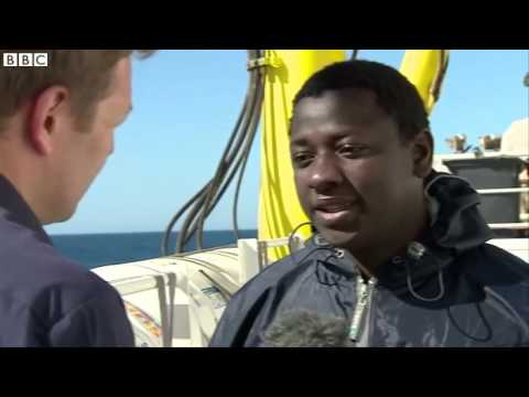 On board rescue boat with migrants travelling from Libya  Libya   BBC NEWS