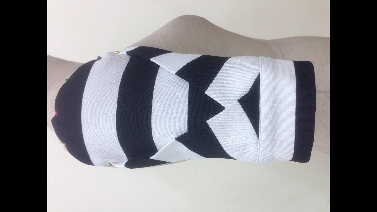 Số 21: Thiết kế tay áo có hai ly xếp đan chéo nhau- The two-ly sleeve design is cross-woven.