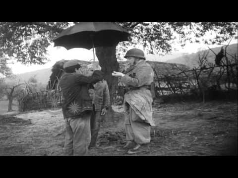 Armed French soldiers move through rural areas of Algeria in rainy weather, and c...HD Stock Footage