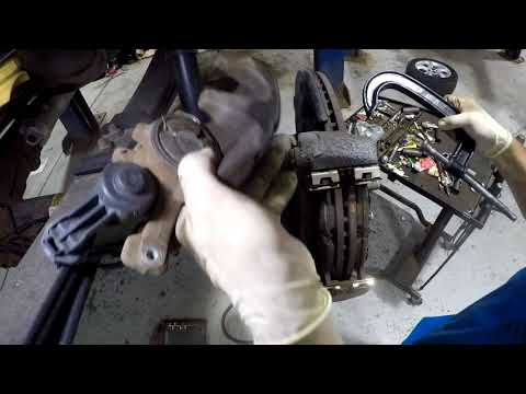 Installing rear brakes on a Ford F150 with Electronic Parking Brake.
