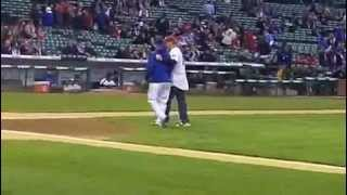 Head Coach Porter Moser Throws Cubs First Pitch