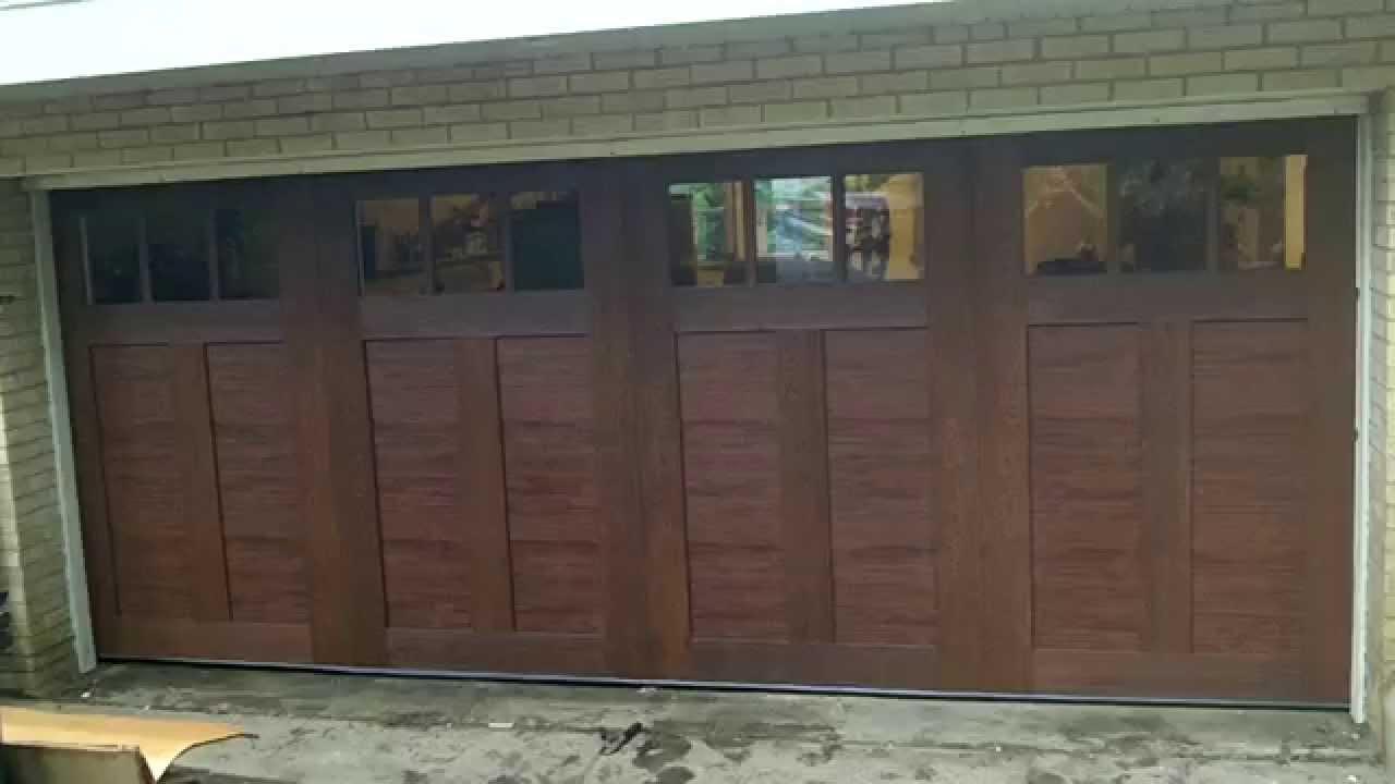 Fake wood carriage house garage doors youtube for R value of old wood garage door