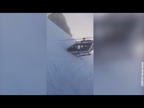 Dramatic helicopter rescue: Pilot flies within inches of mountainside to rescue French skier