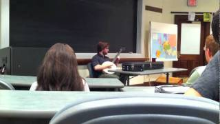 Professor Charles A. Wallace Plays the Fiddle and Banjo