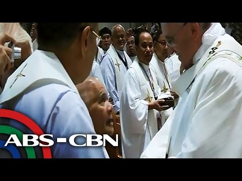 Ill, retired priest gets hug from Pope Francis